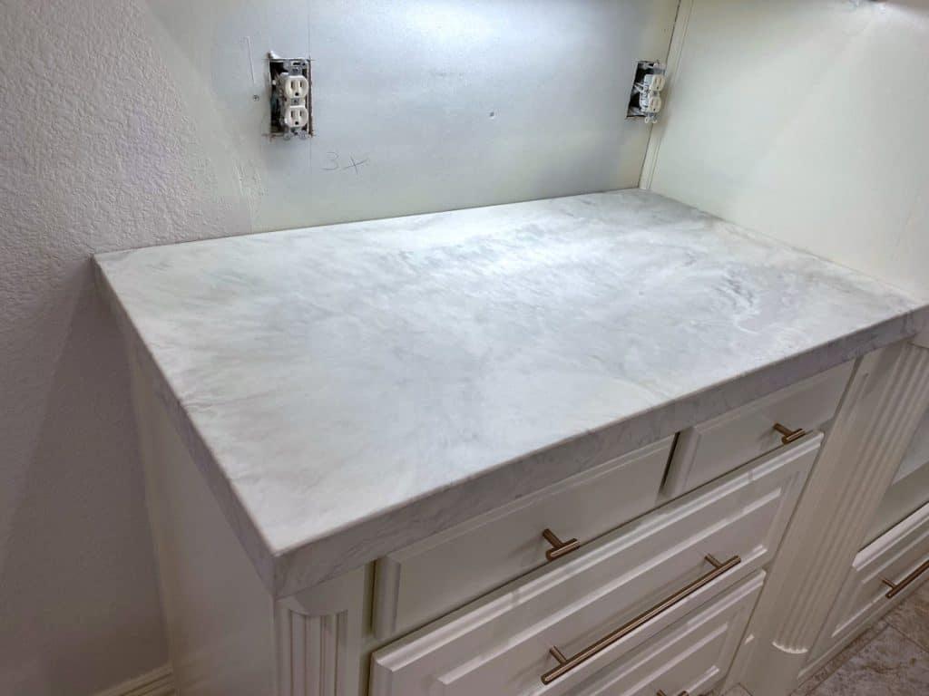 custom white marbled concrete countertops
