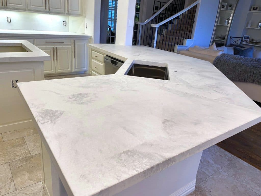 Close up of the white marbled concrete countertops with undermount sink