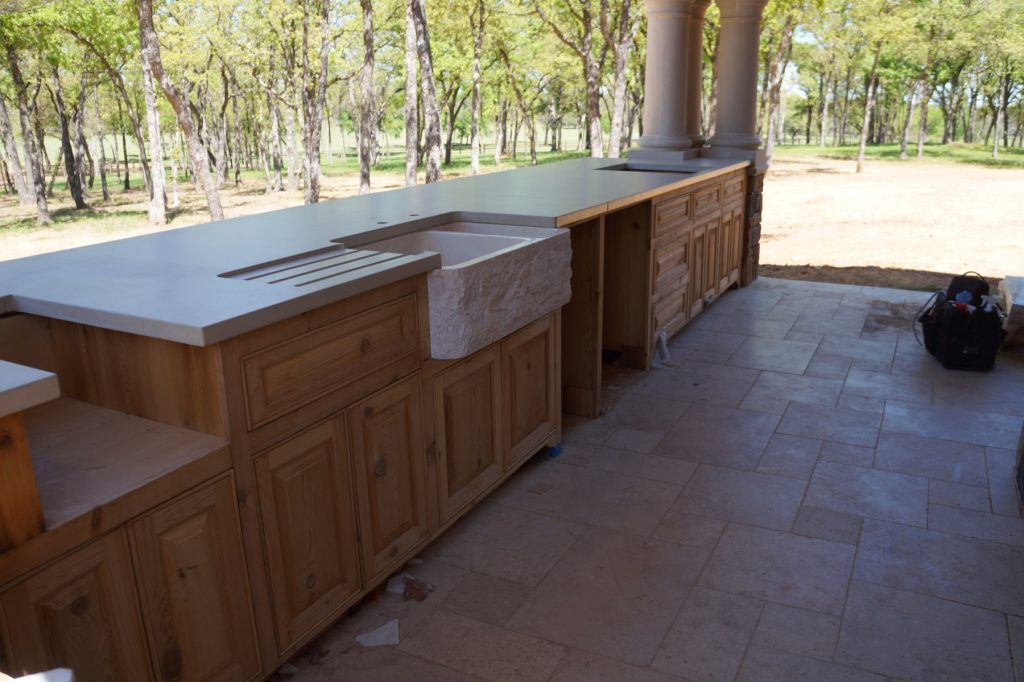 This massive Concrete Outdoor Kitchen was installed in Valley View, Texas. Note the integral drain board/cutting board holder.