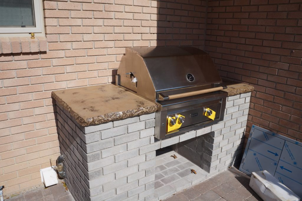 This Concrete Outdoor grilling center may not be huge in size, but it has plenty of character. The tan with brown fill really brings out the detail in the 2 inch thick chiseled edge. This job was installed in Richardson, Texas.