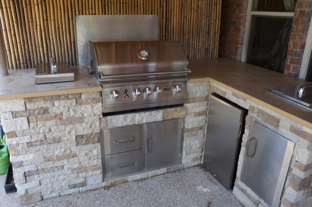 Tan with Brown Fill Outdoor Concrete Countertop installed in Justin, Texas