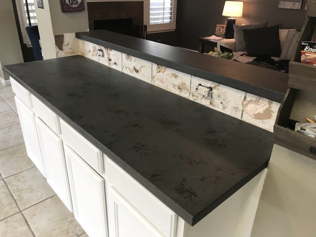 Dark Grey Concrete Countertops with Black Variation for a Remodel in Savannah, Tx
