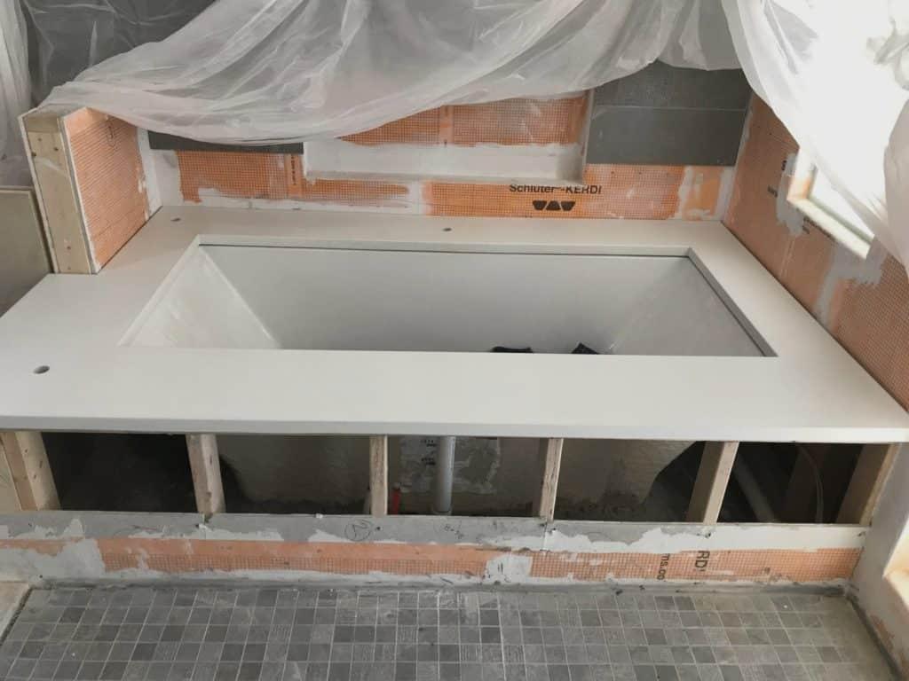 Beautiful White Concrete Bathtub Surround Installed for a Home in Dallas, Tx.