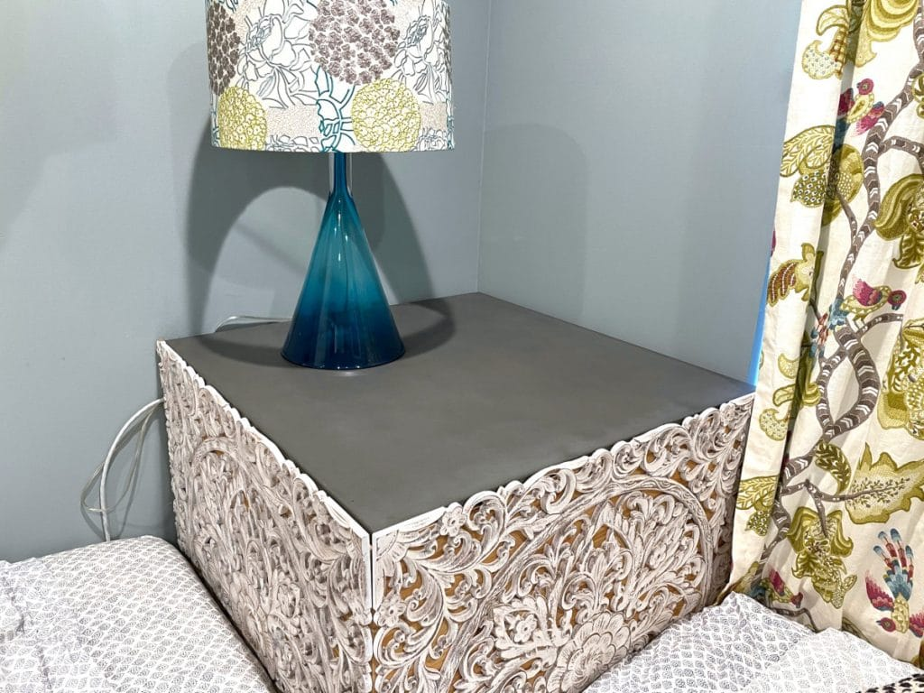 """This slim 3/4"""" slab of concrete doubles as a end table and a lid to a storage box!"""
